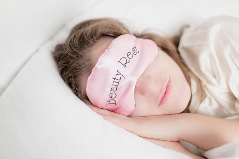 woman-in-beauty-rest-mask-in-pillow